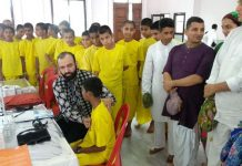 HoD Cardiology GMC Jammu Dr Sushil Sharma examining people at ISKCON Udhampur on Sunday.