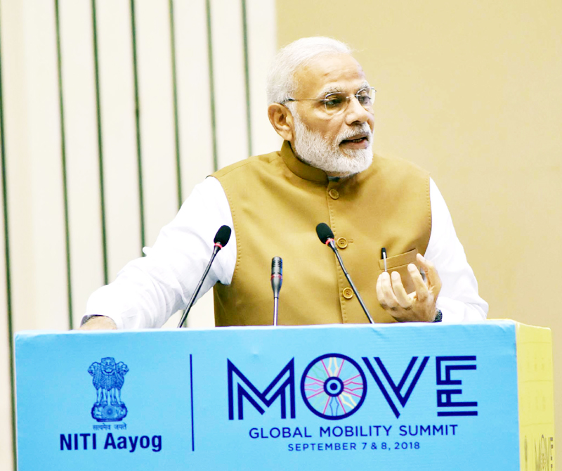 Prime Minister, Narendra Modi delivering the inaugural address at the Global Mobility Summit, organised by NITI Aayog, in New Delhi on Friday.