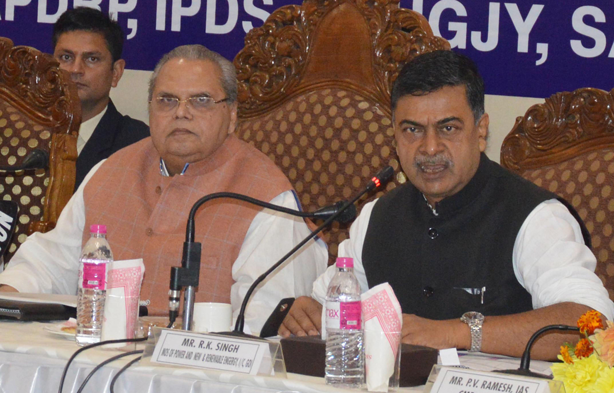 Governor Satya Pal Malik and Union Power Minister R K Singh reviewing J&K's power projects and supply position in Srinagar on Thursday.
