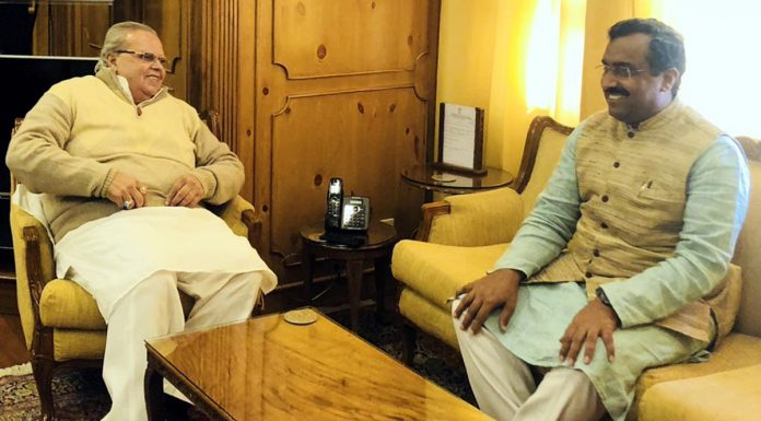 BJP general secretary Ram Madhav meeting Governor Satya Pal Malik in Srinagar on Tuesday.
