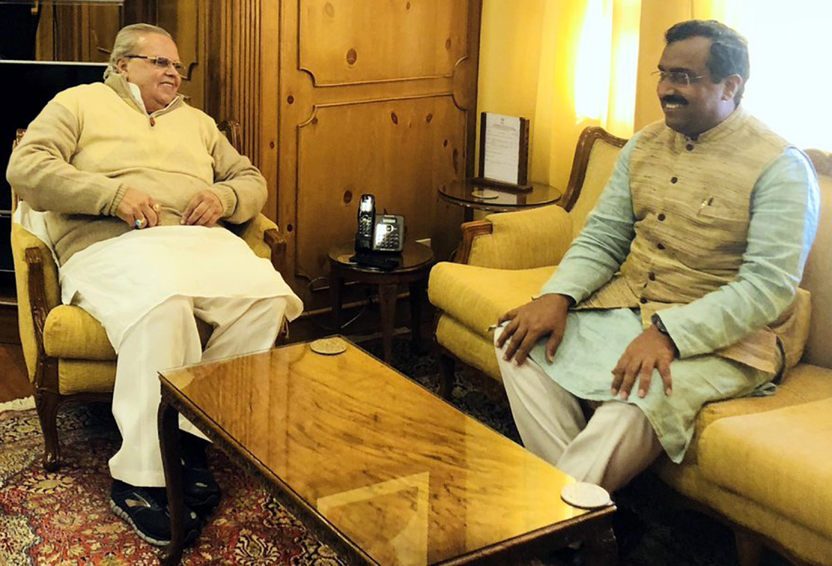 BJP general secretary Ram Madhav meeting Governor Satya Pal Malik in Srinagar on Tuesday.