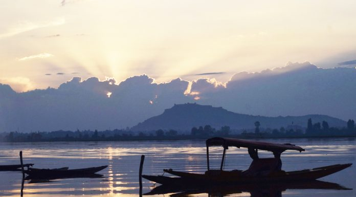 A row of boats standstill on the waters of Dal lake during Sunset in Srinagar.-Excelsior/Shakeel