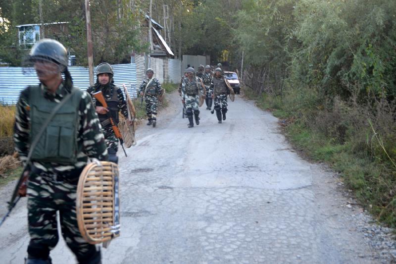 Troops move towards Gazi Gund Dooru in Anantnag during encounter with militants on Thursday. —Excelsior/Sajad Dar