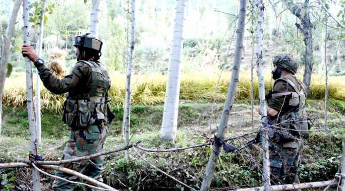 Army during encounter in forest area of Sumular in Bandipora on Thursday. -Excelsior/Aabid Nabi