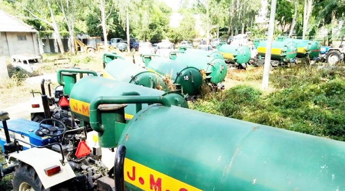 Tractor operated sewage suction machines lying unutilized in yard of UEED at Narwal due to JMC's slackness. -Excelsior/Rakesh
