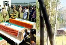 Police officials paying tributes to killed cops at Shopian (left) and smoke billows out at the site of gun battle with militants at Sumlar, Bandipora (right) on Friday. —Excelsior pics by Younis Khaliq & Aabid Nabi