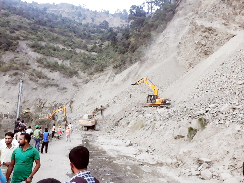 JCBs clearing land slides on National Highway near Ramban on Thursday. —Excelsior/ Parvaiz Mir