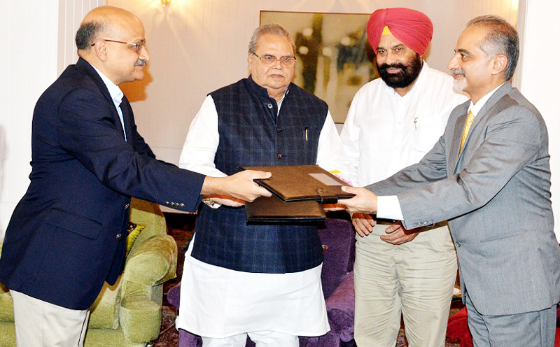J&K and Punjab Chief Secretaries signing the agreement in presence of Governor Satya Pal Malik in Srinagar on Saturday.