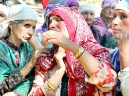Women wail over the killing of Mushtaq Ahmad at Bomai, Sopore on Monday. -Excelsior/Aabid Nabi