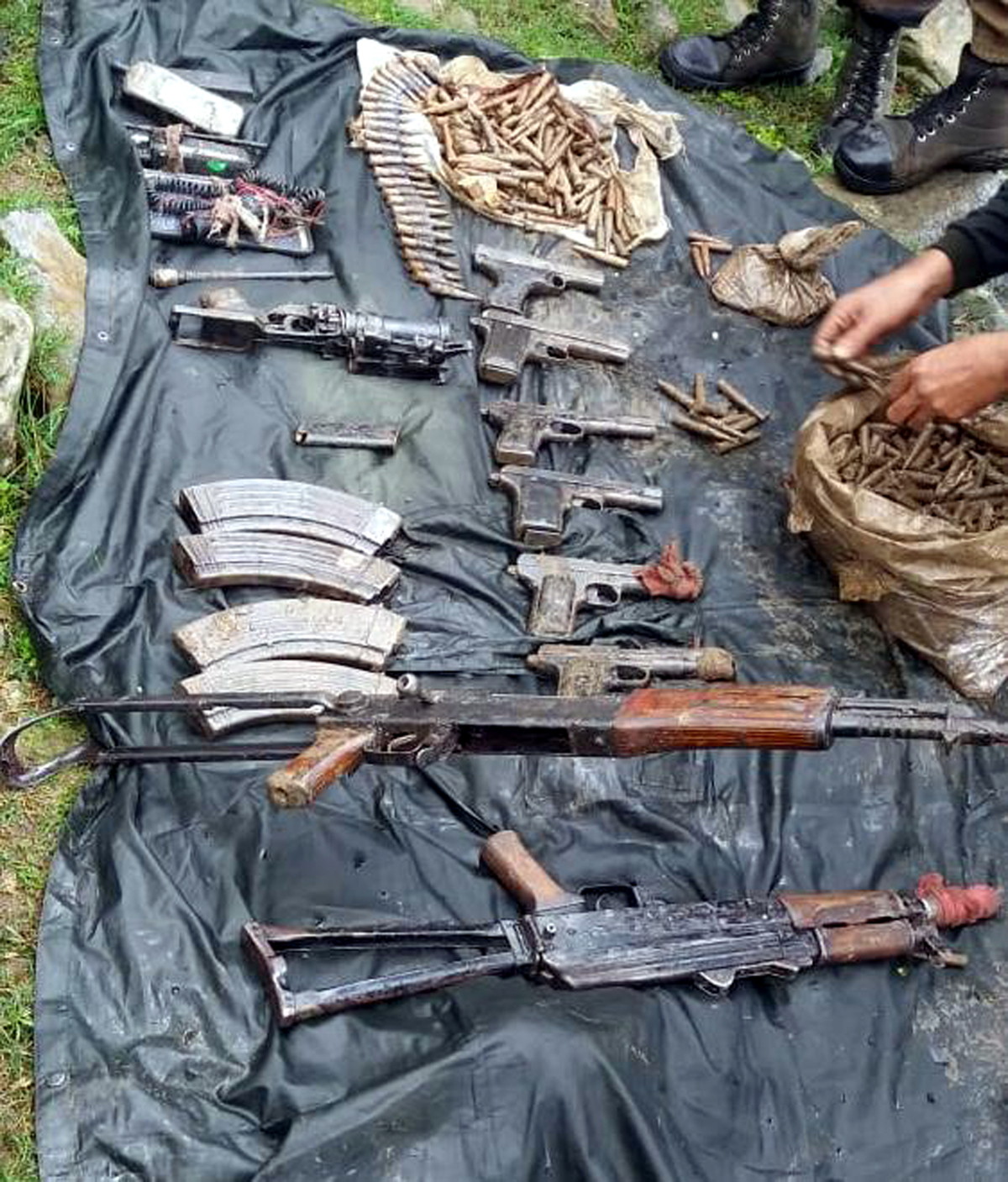 Arms and ammunition recovered by Army and police at Kandi, Rajouri on Tuesday. -Excelsior/Gafoor Bhat