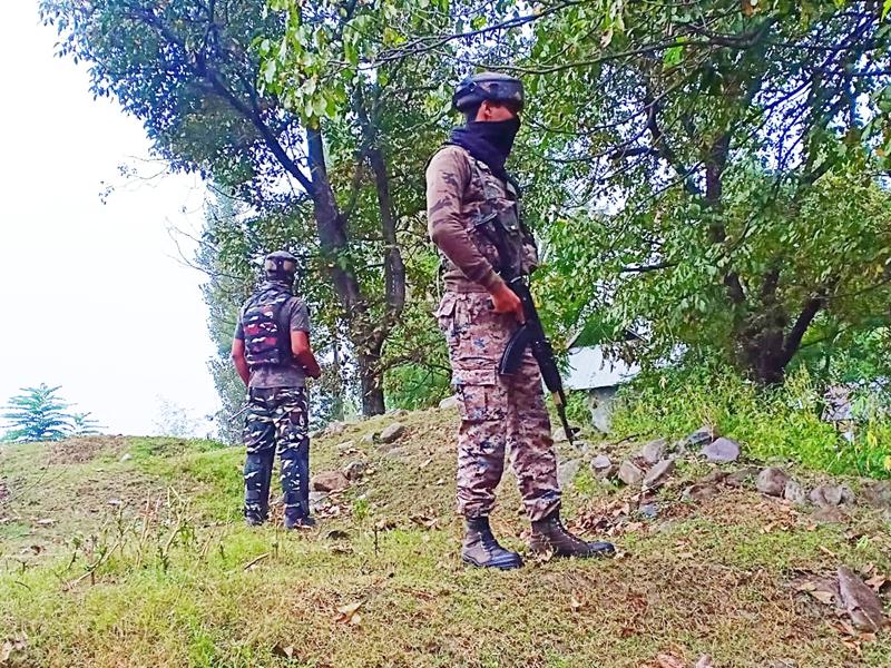 Troops keep vigil at the encounter site in Kulgam on Saturday. —Excelsior/Sajad Dar