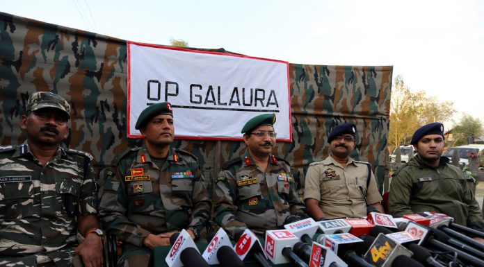 Army and police officers at a press briefing at Handwara on Tuesday. -Excelsior/Aabid Nabi
