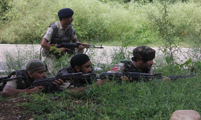 Troops in action during the gun battle at Dirthi, Kakryal on Thursday. —Excelsior/Rakesh
