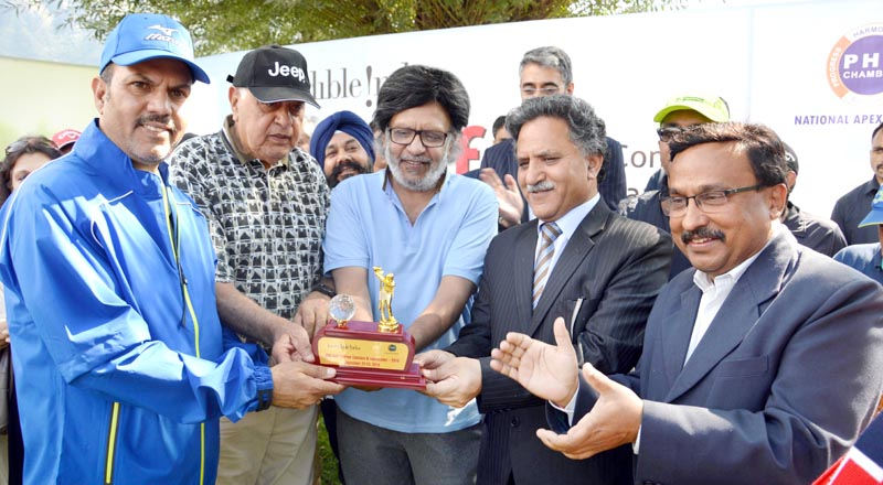 Advisor Khurshid Ganai and former CM and MP Dr Farooq Abdullah during a concluding function of Golf Tournament in Srinagar.