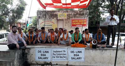 Members of TJAC observing chain hunger strike at Jammu on Wednesday.