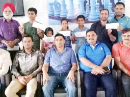 Chess champs posing along with Atul Gupta and other dignitaries in Jammu on Sunday.