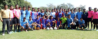 Footballers posing along with the chief guest and other dignitaries at University of Jammu.