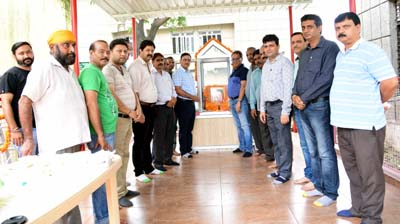 Officers of Agriculture Department paying tributes to revolutionary farmer Bawa Jitto in Jammu on Wednesday.