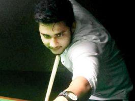 Cueist in action at Billiards Hall, MA Stadium in Jammu. -Excelsior/ Rakesh
