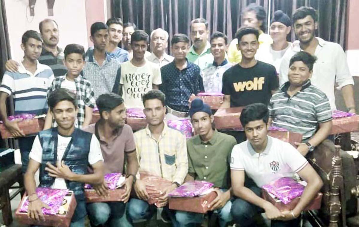 KCCC Jr Cricket team posing along with Romesh Mahajan, former Chairman JKCA and other dignitaries in Jammu.