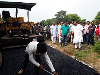 MLA Chander Prakash Ganga starting blacktopping work of a road at village Nathwal in Vijaypur on Wednesday.