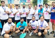 Jammu Runners Group posing for a photograph after winning medals in Half Marathon at Ludhiana in Punjab.
