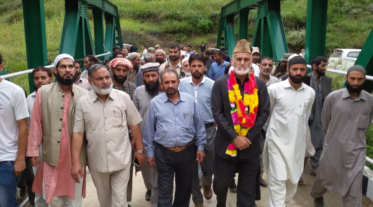 MLA GM Saroori moving along with Govt officials and locals after inauguration of a bridge in Chhatroo area of Inderwal on Tuesday.