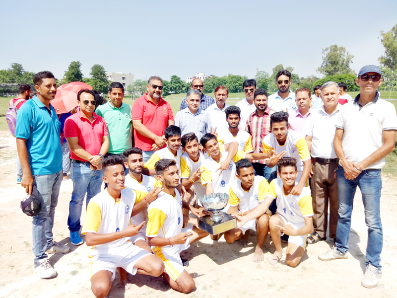 Winning team of Inter-Collegiate Kho-Kho Tournament posing along with dignitaries and officials in Jammu.