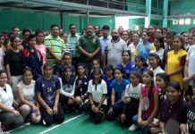 Young shuttlers posing along with dignitaries and officials during the inaugural ceremony of Inter-Collegiate Badminton Tournament.