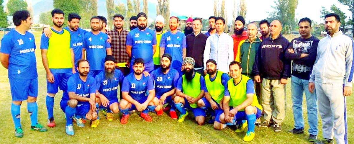 Winners of Football tournament posing along with dignitaries and officials in Baramulla.