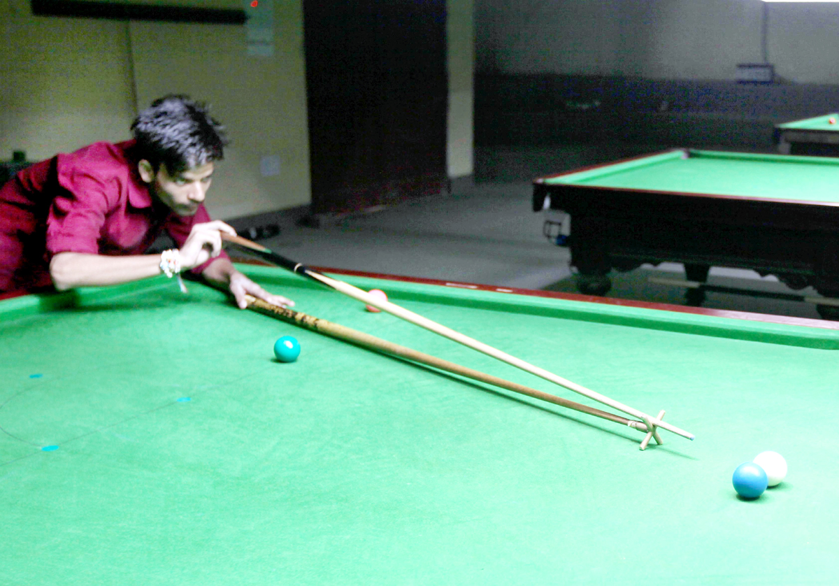 Cueist in action during a match of Sub Junior Snooker Championship.