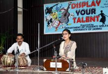 Student performing during 'Display Your Talent' programme at University of Jammu.
