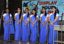 Students performing during Group Song competition at Brig Rajinder Singh Auditorium, JU.