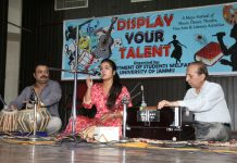 Participant performing during Light Vocal Solo competition at Brig Rajinder Singh Auditorium, University of Jammu.