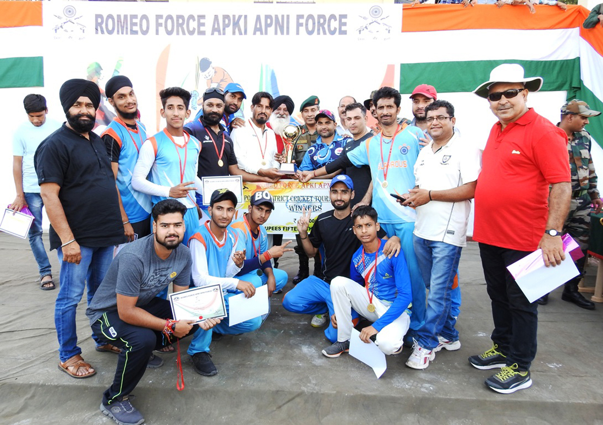 Winners of Cricket Tournament posing for a group photograph along with dignitaries at Sports Stadium in Poonch.