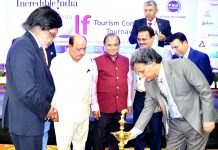 Advisor Khurshid Ganai lighting ceremonial lamp while inaugurating Golf Tournament in Srinagar.