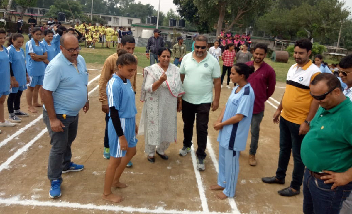 Toss of coin before the commencement of Kho-Kho match at JU.