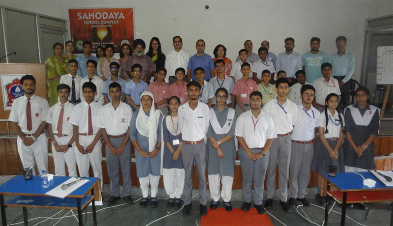 Winners of CBSE Sahodaya Interschool competition posing along with the chief guest and other dignitaries.