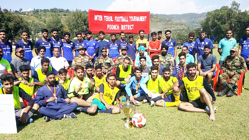 Participants of Football Tournament organised by Army posing for a group photograph on Wednesday.