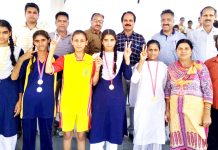 Meal winners of Inter-School U-17 Girls Athletic Meet posing along with dignitaries and officials in Jammu.