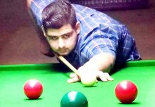Cueist in action at Billiards Hall, MA Stadium in Jammu. -Excelsior/Rakesh