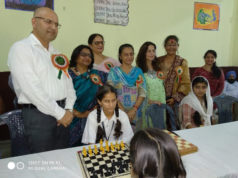 Winners of Inter-School Chess Championship posing along with dignitaries and officials.
