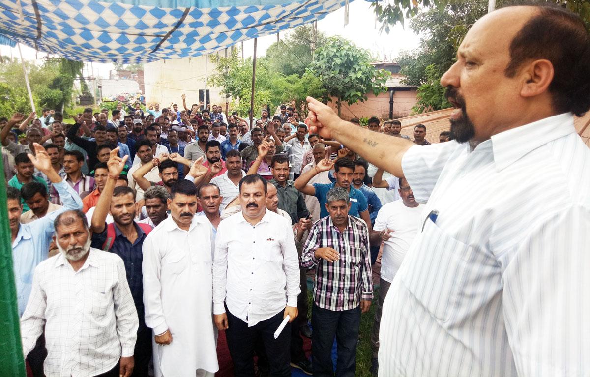 Senior Trade Union leader, Som Nath addressing PHE employees' rally at Udhampur on Monday.