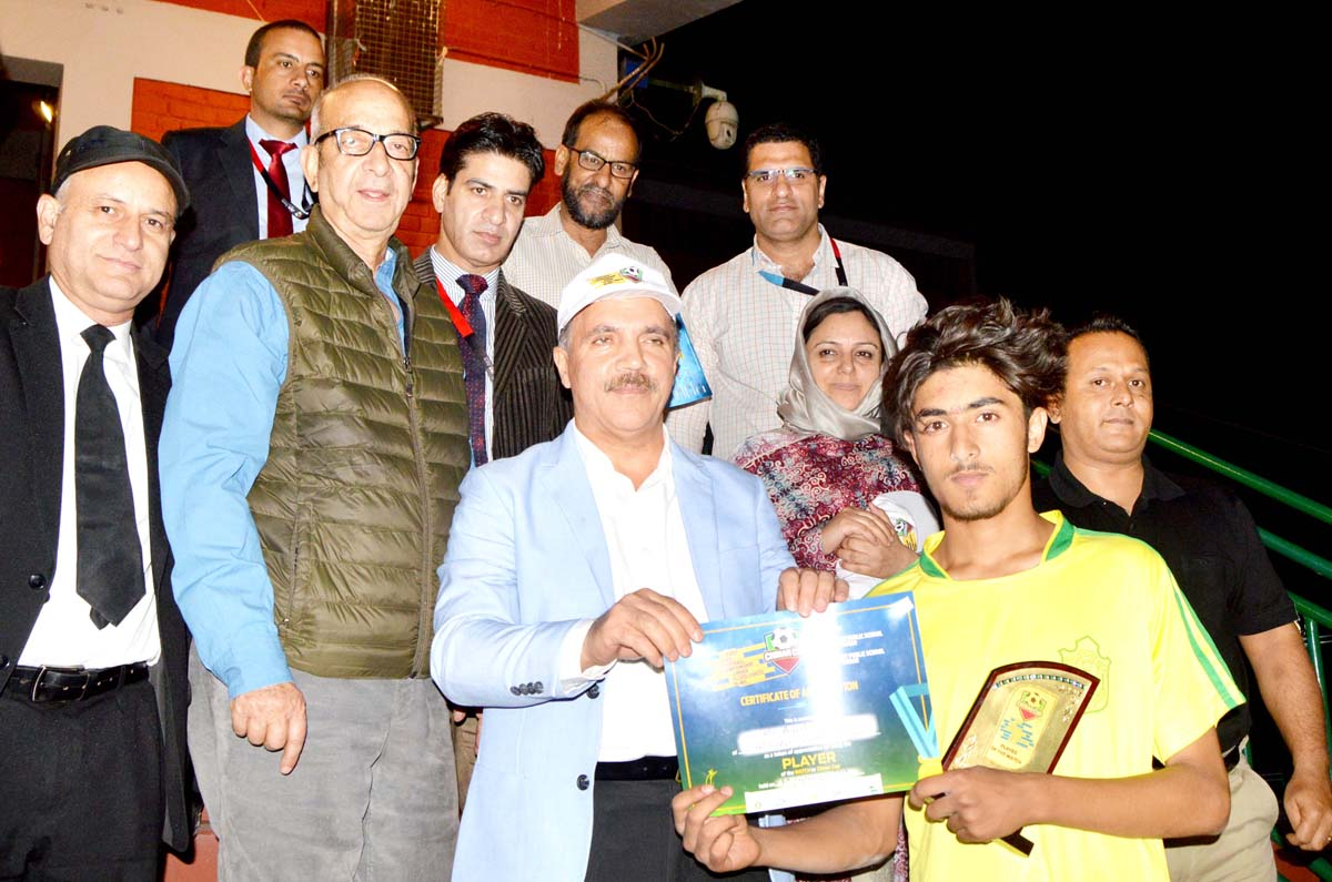 Winners of Football match receiving trophy from the chief guest at DPS, Srinagar.