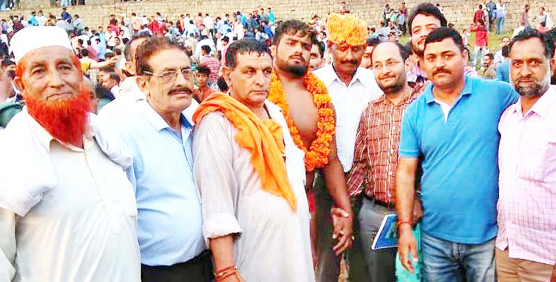 Organisers felicitating Wrestler after winning the title.