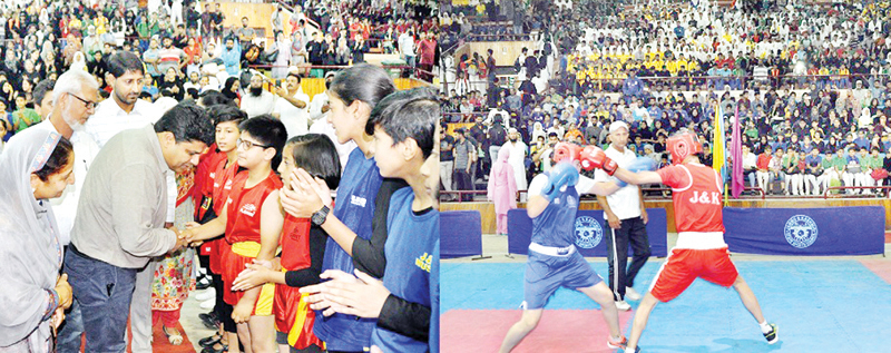 Secretary YSS interacting with players while declaring open Martial Arts competition and players in action during a match at Srinagar on Thursday.