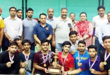 Dignitaries awarding the winner team of Badminton Championship.