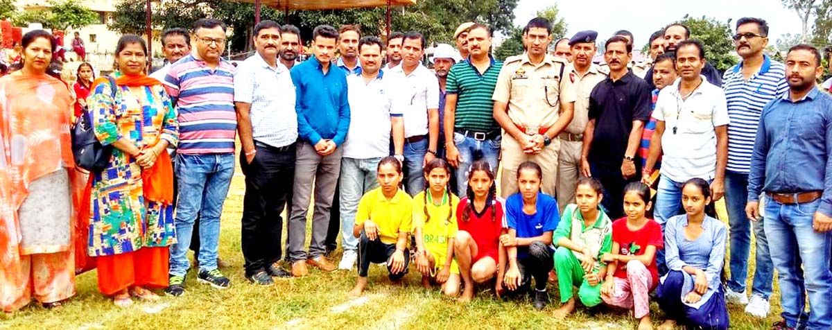 Winners posing along with dignitaries and officials during Under-14 girls athletic meet at Udhampur.