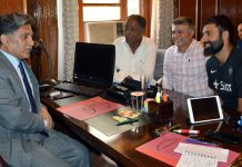 Cricketer Parvez Rasool and other members during a meeting with Advisor to Governor, Khurshid Ganai in Srinagar.