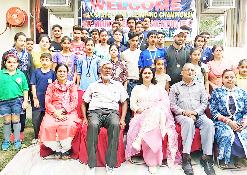 Sport climbers posing along with dignitaries and officials in Jammu on Thursday.